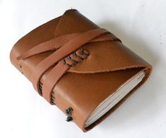 DIY LEATHER JOURNAL: I made this journal with small left over scraps of paper and recycled leather. It is a simpler version of a journal, with no need for really specific tools. Diy Leather Projects, Leather Diy Crafts, Leather Gifts, Leather Crafting, Diy Leather Books, Leather Jewelry, Leather Bags, Leather Travel Journal, Leather Notebook