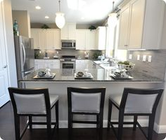 grey/silver/white kitchen. like bar stools with nail head trim