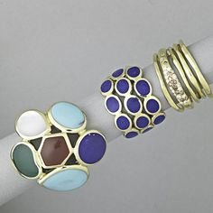 THREE IPPOLITA 18K GOLD RINGS  Polished Rock Candy six-stone ring with turquoise, carnelian, lapis, chrysoprase and mother-of-pearl; three row ring with lapis; five row band with colorless and champagne diamonds, approx. .20 ct. TW. 22.7 dwt. (35.3 gs.), sizes 7 1/2