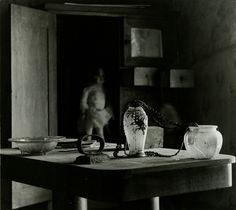 Untitled (still life with doll in background) by Ralph Eugene Meatyard