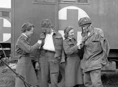 Nursing sisters of Princess Mary's Royal Air Force Nursing Service talking with wounded soldiers, Beny-sur-Mer, France, 16 June 1944. - Library and Archives Canada MIKAN 3524151