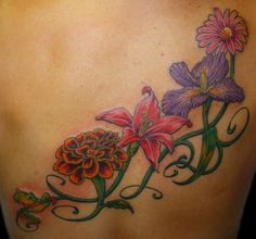 Sisters tattoo- Sisters are different flowers from the same garden - four flowers on outer foot