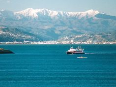 Looking across to the snow-capped Rimutuka Range from Oriental Bay, Wellington, NZ.