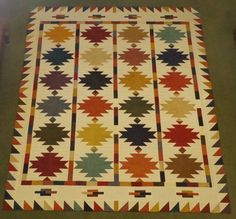Sedona Southwest quilt pattern, MODA Primitive Muslin Flannel, 2 layer cakes and 1 charm pack, plus muslin flannel.