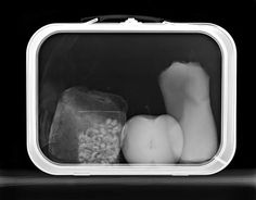 X-ray Lunchbox Ok, so apple, sandwich, bag of nuts or Cornnuts.  Is the last thing a Sunkist pouch?  Sure doesn't look like a thermos or juice box that I've ever seen.