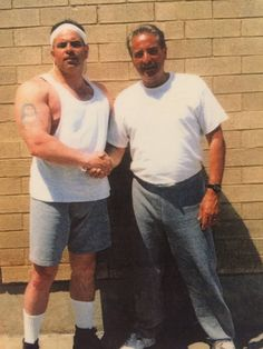 "Tony Fiore poses with New York City crime boss John A. ""Junior"" Gotti, left, in a federal prison yard. C ourtesy of the Providence Journal . Charles Kennedy, Providence Journal, Mafia Families, Federal Prison, Run To You, Police Detective, Tough Guy, State Police, Original Music"