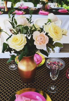 Different roses arranged in a classic gold vase make for an elegant bridal shower centerpiece!