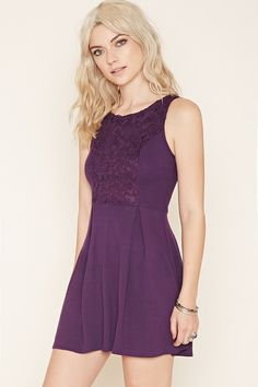 A sleeveless knit mini dress with crochet overlay on the front and back of its bodice, subtle inverted pleats on its skirt, a skater silhouette, and an exposed back zipper. #blueroofind