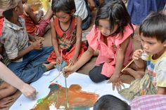 Girls paining in art lesson, UWS Ka Narng Ket, Cambodia. UWS Ka Narng Ket School was completed June 2014. The school will open in October 2014, with 3 classrooms, solar power, a well, toilets and a teacher house.