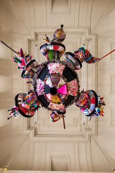 Mary Poppins, 2010  Artist +Source: Joana Vasconcelos  (view from below)     Handmade woollen knitting and crochet, industrial knitted fabric, fabrics, ornaments, polyester, steel cables700 x 600 x 600 cmCollection of the artist    Crafted from the combination of pre-existing materials and mass-produced objects along with other hand-made crochet and knitted fabrics, Mary Poppins, gives continuity to the Valkyries series (started in 2004 with Valkyrie #1).