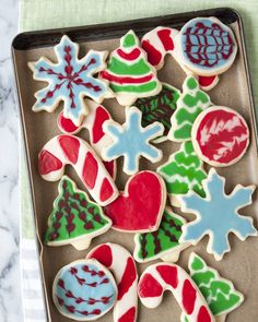 Skip the royal icing. Skip the pastry bags and the piping tips. Embrace your lazy inner baker. If you covet those glossy, perfectly iced sugar cookies but never felt like your pastry skills were quite on par with doing it yourself, I think I can help. This is the simplest, most straight-forward way to decorate cookies with icing that I know.