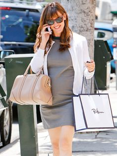 SHOP GIRL Jennifer Garner – who just struck down rumors that she is pregnant with her fourth child – enjoys a day of shopping in Brentwood, California, on Tuesday.