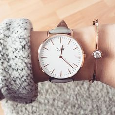 this is called a cluse watch...similar brand is MVMT but i like that the band is gray and then the face is simple and the color can be rose gold or gold but i think i like rose gold in this one