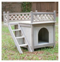 This small dog house has it all and a roof top deck for sunning on warm summer days. The cedar construction and raised base architecture allows you the freedom to keep this house indoors or outdoors, Small Dog House, Small Dogs, Wooden Dog House, Cool Dog Houses, Puppy House, Rooftop Patio, Niches, Types Of Dogs, Animal House