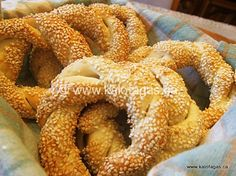 Greek Koulouria - Braided bread twists with sesame seeds. Soft and chewy on the inside, crusty on the outside. Roll them up tighter for a great sandwich roll. Fun Baking Recipes, Cooking Recipes, Bread Twists, Greek Pastries, Bread Winners, Greek Sweets, Greek Easter, Braided Bread, Greek Cooking