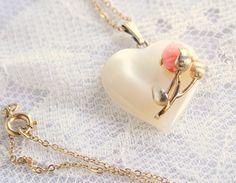 Vintage Carved Angel Skin Coral Rose Mother of Pearl Heart Necklace 14k Gold Art Nouveau. $120.00, via Etsy.