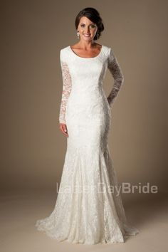 Cassandra | Modest Wedding Dresses | Sleeves | LatterDayBride & Prom | SLC | Utah | Worldwide Shipping | LDS Bridal Gowns | Complete your wedding with this amazing long sleeved modest wedding gown, complete with illusion lace sleeves, a mermaid fit and a stunning sweep train.    Gown available in White, Ivory or Cafe/Ivory    *Gown pictured in Ivory