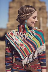 This eye-catching asymmetrical shawl is worked side to side in varying stripes of garter stitch, while the intarsia motif is simple stockinette stitch. A light fringe is added in finishing to complete this Southwest-inspired knit.