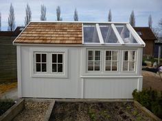 A bespoke shed with greenhouse
