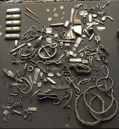 A selection of Viking silver from the Cuerdale hoard in the British Museum. Buried in around 905, found in 1840. The Cuerdale Hoard is a hoard of more than 8,600 items, including silver coins, English and Carolingian jewelry, hacksilver and ingots. It was discovered on 15 May 1840 on the southern bank of a bend of the River Ribble, in an area called Cuerdale in South Ribble near to the city of Preston, Lancashire, England.  ~Vidar