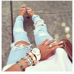 ripped jeans, stacked braclets and shoes!