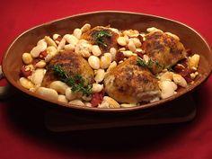 Gegrilde kip uit de oven met chorizo, wittebonen, knoflook en ui.