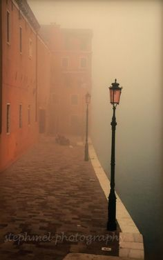 Old street lamps in Venice, Italy, and the magic of a misty morning by the canals.