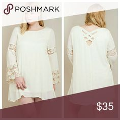 IVORY Dress With Lace Accents Ivory dress with criss-cross detail on back and bell sleeves with lace accents at bottom of bell and around upper arm. Fabric is a nice rayon crepe, slightly sheer, with a solid lining that is a little stretchy. Dresses