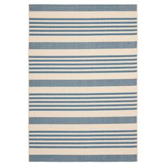 Anchor your patio seating group or dining set with this loomed rug, featuring beige and blue stripes.   Product: Rug