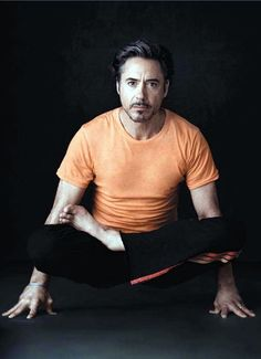 oh my, R Downey Jr in orange T and doing yoga... love! S~) Have to repin RDJ.