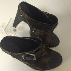 "BCBG Generation camp Pony Hair Clogs Shoes 7 B Fabulous shoes from BCBG Generation in size 7 B. Black leather toes with camo pony hair uppers. 4.5"" heels. Studs around the sides and buckle across the top. Bcbg generation Shoes Mules & Clogs"