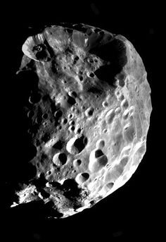Phoebe, moon of Saturn. I LOVE this little moon. She orbits Saturn in the opposite direction of the other moons. She's older than the others, and she's had it rough from time to time. Right on, Miss Phoebe!What a Gal !!!