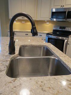 Delta faucet (Cassidy?) & windermere quartz by Cambria.