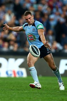 Robbie Farah of the Blues kicks during game one of the ARL State of Origin series between the New South Wales Blues and the Queensland Maroons at ANZ Stadium on June 2013 in Sydney, Australia. Rugby League, Rugby Players, Wests Tigers, Australian Football, Rugby Men, Beefy Men, Sydney Australia, South Wales, Athletes