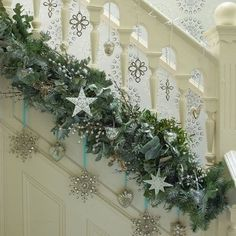 Christmas garland  put on the bottom of the railing :}. So cleaver and a great way to display ornaments as well!   Www.hillfarms.com LOVES this idea.