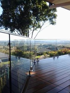 house decking with frameless glass balustrade - Google Search