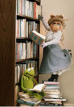Miss Piggy is a classic. And in front of bookshelves? So chic.