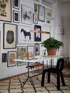 Eclectic art wall layout of mostly black and white prints - Art Wall Ideas & Decor