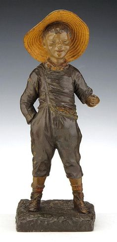 (French, active 1895-1925)A terracotta figure of a boy wearing a straw hat Signed 'G. Omerth' to the base 41 cm high