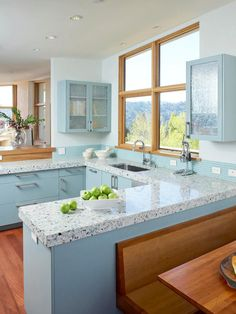 The Icestone terazzo countertops in this kitchen by Massucco Warner Miller are made from recycled glass bottles that give the surface a sea-glass-like sheen. The cabinets were painted a pale turquoise to match. When attempting to match kitchen materials, remember that paint can always be tinted to coordinate with your countertop, cabinets or fabrics, so choose the paint last. Recycled Countertops, Kitchen Countertop Materials, Kitchen Countertops, Colorful Kitchen Decor, Kitchen Colors, Kitchen Design, Kitchen Ideas, Colorful Kitchens, Kitchen Units