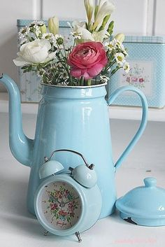 Pastel blue kitchen decor ideas - beautiful light blue old fashioned coffee pot filled with flowers