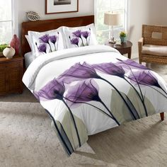 Artist Albert Koetsier created this calming, beautiful floral image on Laural Home's Gentian Hope Comforter with a special technique using an x-ray machine and