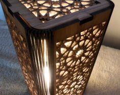 Laser cut phoenix rising rising lamp, shoji style table lamp provides soft, warm light filtered through high quality rice paper filling the room with a welcoming, relaxing glow. This dramatic table lamp sets the look for a whole room. Created with beautiful hand-finished maple or cherry plywood in a oriental style lamp, creating a sense of peace and ease. Created with elements of Zen, Feng Shui and oriental design. Excellent for use in pairs on night stands or living or den/library end…