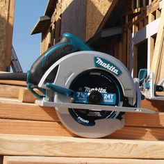 The Makita 5007MG 7-1/4 in. Magnesium Circular Saw features highly durable magnesium components and a powerful 15 AMP Makita-built industrial motor. The 5007MG seamlessly balances weight, power, durability, and ease of use, making it the most refined circular saw on the market. A built-in dust blower clears the line of cut for more accurate and precise cuts. The 5007MG is built for framing walls, floors, and roofs using a range of dimensional lumber and dense engineered lumber, including… Circular Saw Jig, Circular Saw Reviews, Best Circular Saw, Woodworking Power Tools, Tool Bench, Bottle Carrier, Makita, Particle Board, Diy Tools