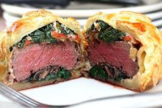 Recipe for Individual Beef Wellingtons with Mushroom, Spinach, Roasted Pepper, and Blue Cheese Filling. Decorate them like little gifts for the holidays!