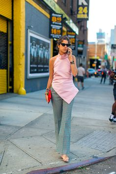 by Sania Claus Demina Red, pink, florals, wide legged, statement t-shirt and ruffles. New York fashion week is coming to an end and we've taken a closer look at what the fashion bloggers have been...