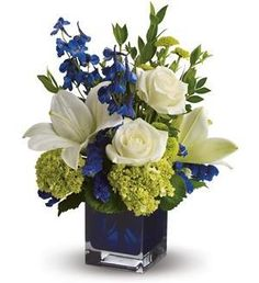 Wedding Flower Arrangements Serenade in Blue - A song for the eyes, this exquisitely lyrical bouquet in a chic contemporary glass cube vase is sure to impress anyone. Those with an eye for design are in for a special treat. Blue Flower Arrangements, Wedding Flower Arrangements, Floral Centerpieces, Flower Vases, Wedding Bouquets, Blue Wedding Centerpieces, Royal Blue Wedding Decorations, Table Arrangements, Cactus Flower