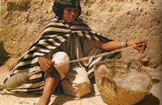 Africa: Berber girl spinning wool, Morocco