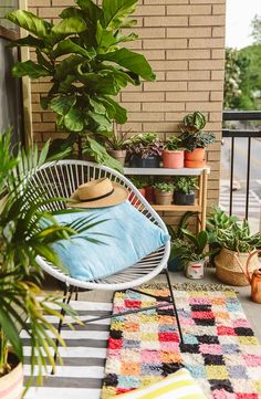 Inspiration for apartment balcony. Small but colorful, with lots of plants and layered patterns.