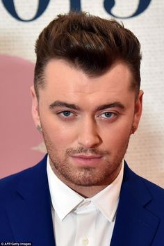 Top nominee Sam Smith looks dapper as ever at the BRITs 2015